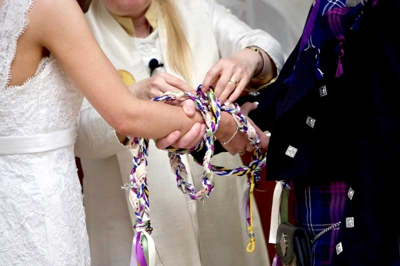 Get Married Whilst At Carden Cottages Image of 2 People doing Celtic handfasting ritual