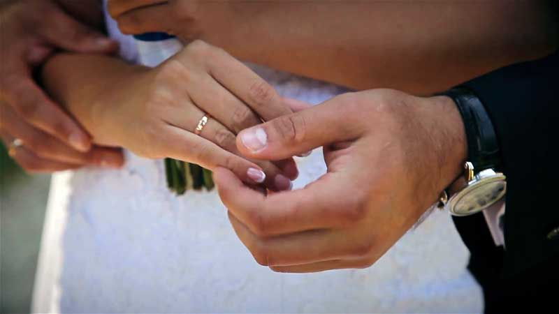 Couple holding hands renewing their wedding vows
